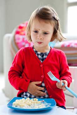 Child Experiencing Discomfort and Holding Stomach - Signs of Gastroesophageal Reflux
