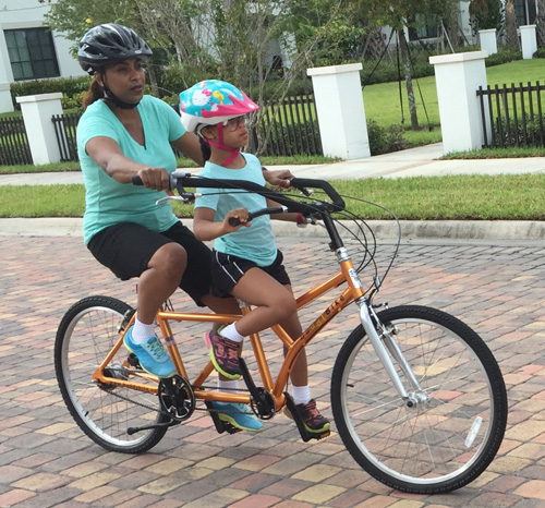 Mother and daughter on Buddy Bike alternative tandem bike